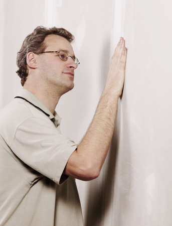 Man checking the smoothness of a wall Stock Photo - 7197114
