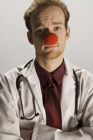 Doctor wearing a clown's nose Stock Photo - 7197678
