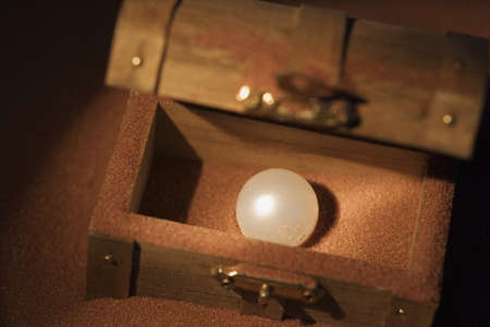 Pearl in a wooden box photo