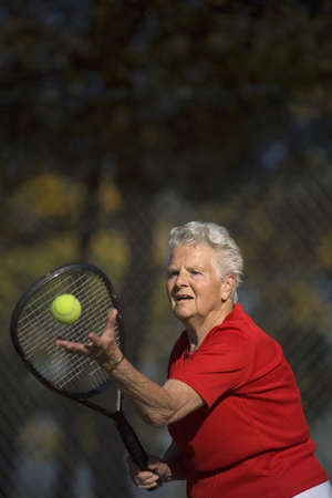 seventy something: Woman playing tennis Stock Photo