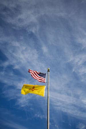 raniszewski: American flag and New Mexico flag on flag pole   Stock Photo
