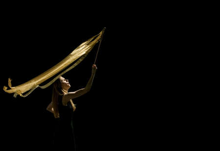 Woman waving flag in black background Stock Photo - 7197914