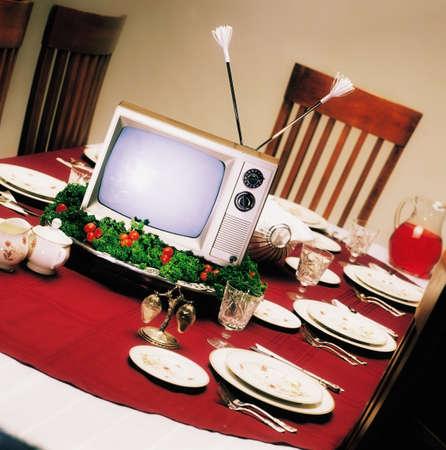 ron: TV on platter on dinner table