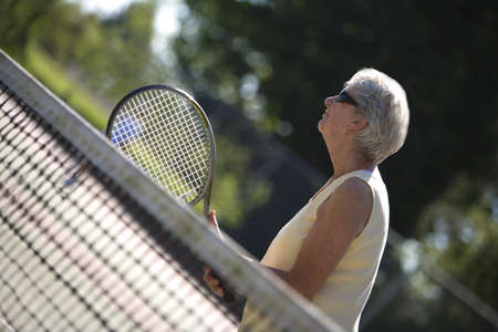 50 something fifty something: Woman ready to play tennis