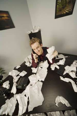 Businessman on phone with paper scattered Stock Photo - 7198246