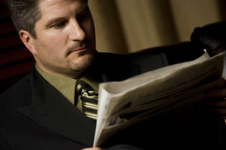 fifty something: Businessman reading the paper