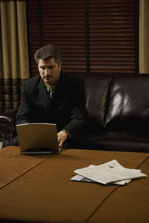 50 something fifty something: Businessman working on his laptop