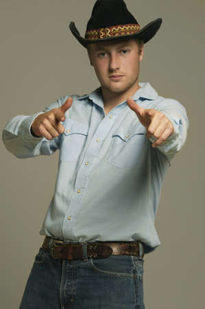 warkentin: Cowboy pointing with two hands ahead Stock Photo