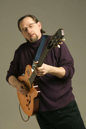 warkentin: Middle aged man playing the guitar
