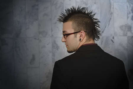 leah: Profile of man with a mohawk