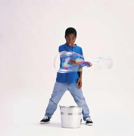 children  play: Boy making bubbles