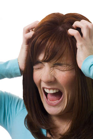 holding the head: Woman holding head in anguish Stock Photo