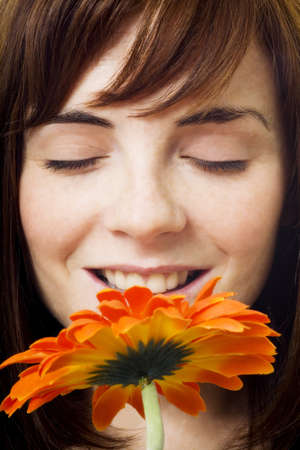 thirty something: Women enjoying smell of flower