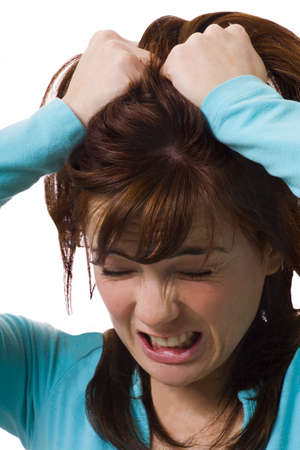 antagonistic: Woman holding head in anguish Stock Photo