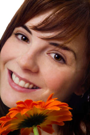 30 something women: Woman smiling with flower