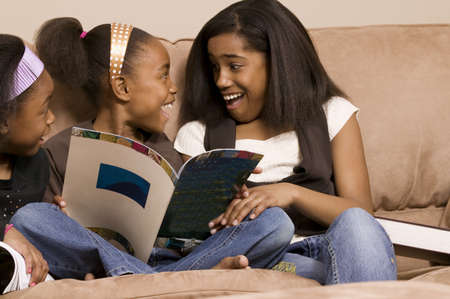 family unit: Girls excited about books