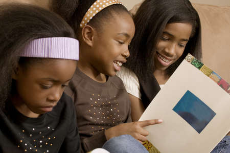 family units: Girls reading together