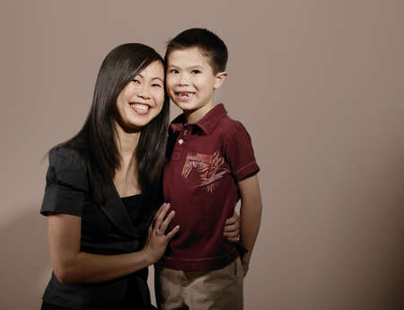 A mother with her arm around son's waist, smiling Stock Photo - 7200564