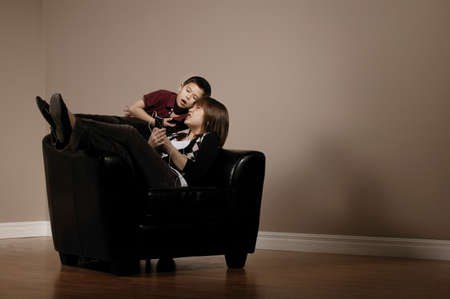 Little boy bothering his older sister