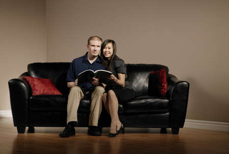 Couple reading together on the couch photo