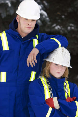 Tradesman and junior tradeswoman photo