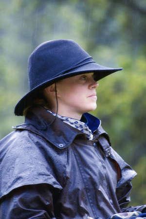 rainwear: Cowgirl in the rain   Stock Photo