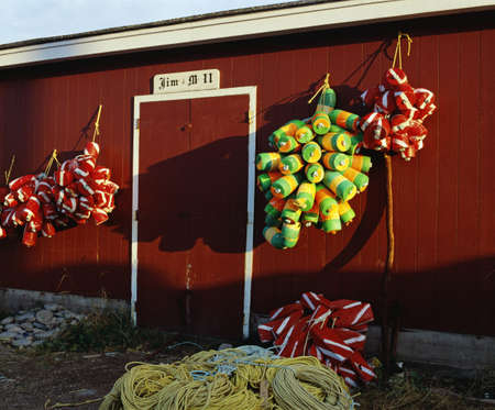 buoys: Fishing buoys hanging on an outside wall