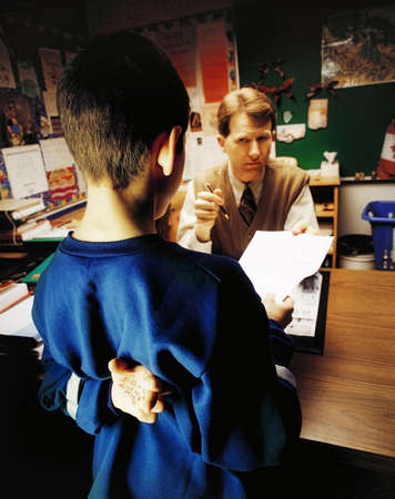 cheating: Student getting in trouble with teacher Stock Photo