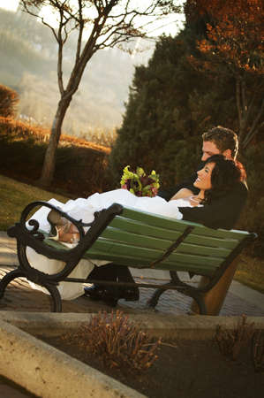 A couple on a bench in autumn