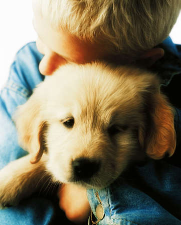 affection: Boy hugging puppy Stock Photo