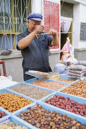 seventy something: Man selling nuts and dried fruit in Dunhuang, China