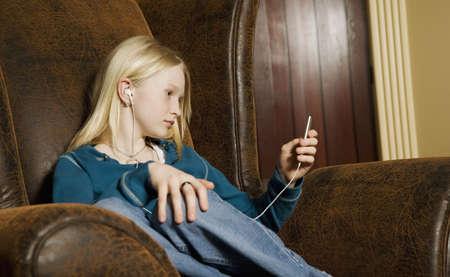 Teenage girl listening to music photo