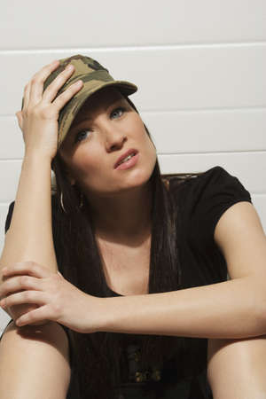 Young woman sitting with head in hands Stock Photo - 7200560