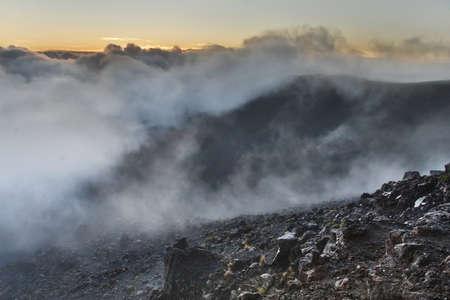 smoldering: Haleakala crater with smoke Stock Photo