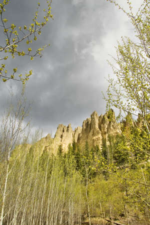 dutch: Dutch Creek hoodoos and spring foliage with cloudy sky   Stock Photo