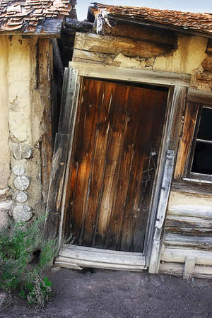 impoverished: Abandoned house with door