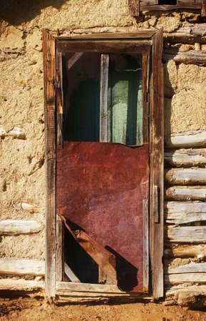 shanty: Broken door at an empty house