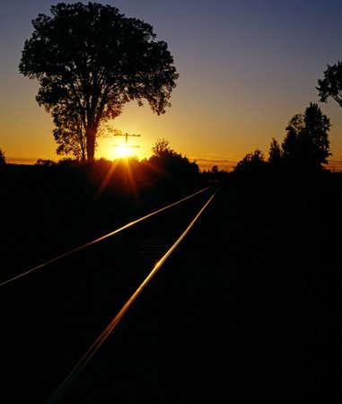 Train tracks at sundown photo
