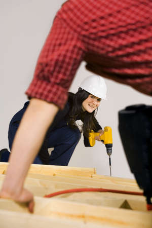 tradeswomen: Carpenters working with power tools
