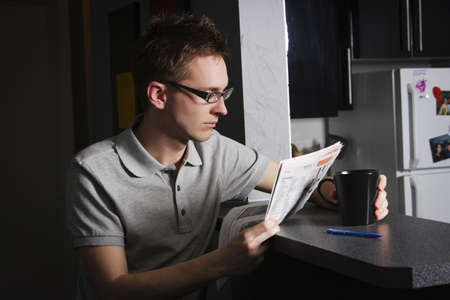 bookish: Man reading at home Stock Photo