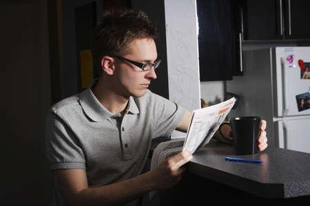 bookish: Man reading at home Stock Photo