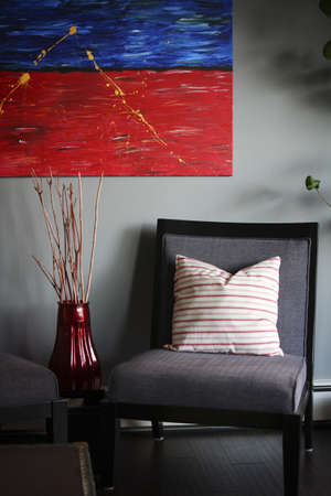 cor: Chair with painting and vase