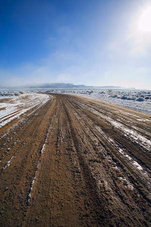 raniszewski: Melting snow on dirt road Stock Photo
