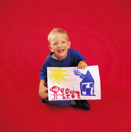 Child posing and holding painting photo