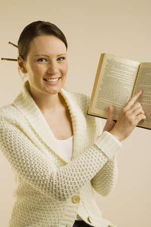 A woman smiling and showing Bible Stock Photo
