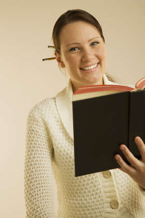 bookish: A woman smiling and reading book