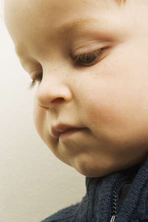 dispirited: Young boy looking down