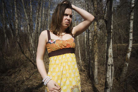 angst: Troubled woman in wooded area