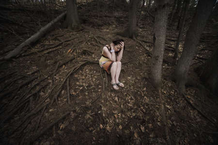 hardships: Woman alone in the forest