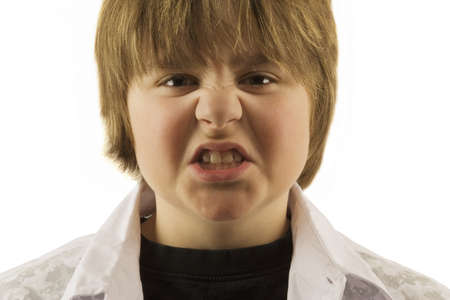 antagonistic: Young boy making silly face